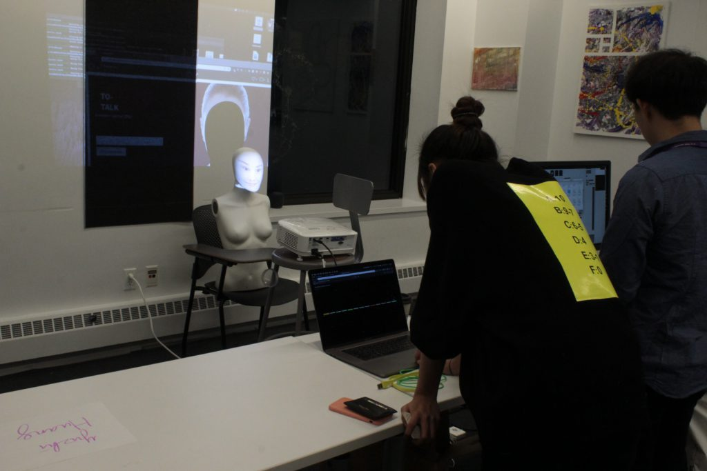 student interacting with a student project on a laptop at ideation and prototyping showcase