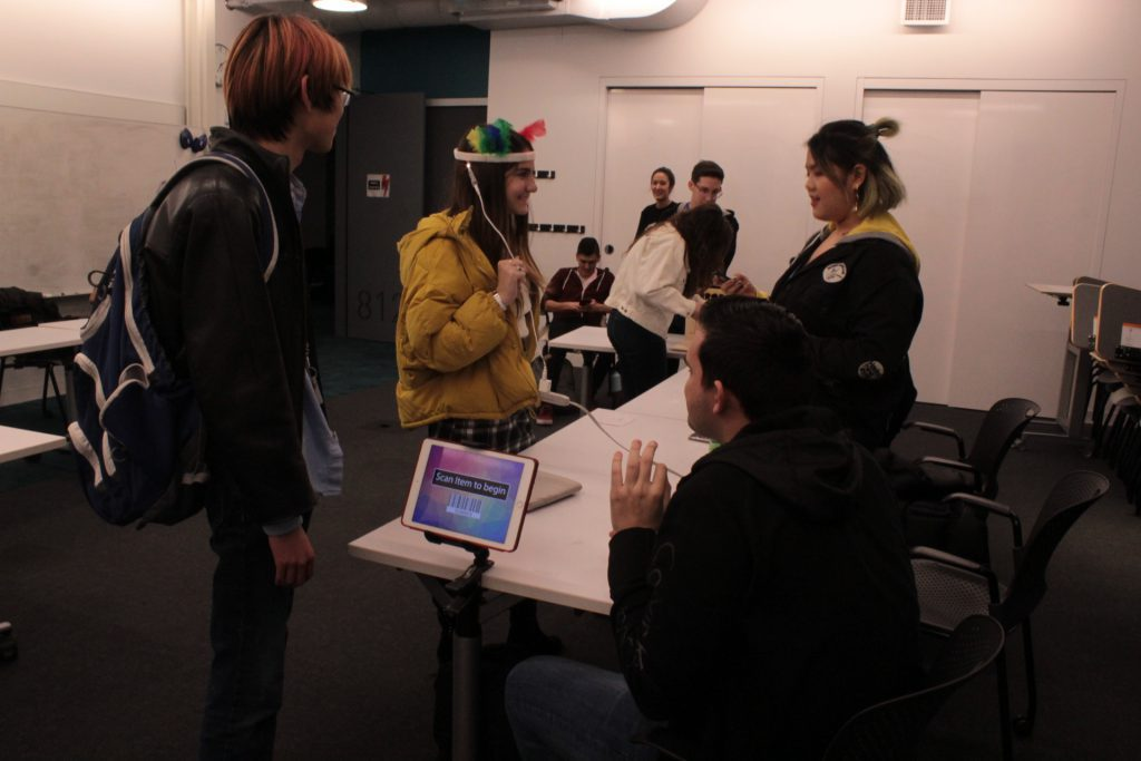 students interacting with various projects at the ideation and prototyping showcase