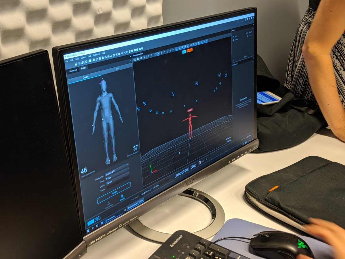 Computer screen of human 3d model standing in A-pose.